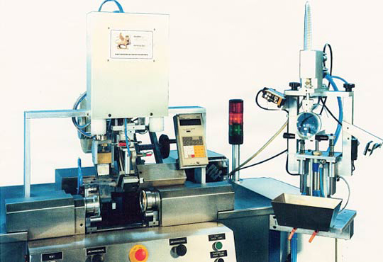 Mould assembly and automatic filling line for the production of CR39 lenses (optical industry).